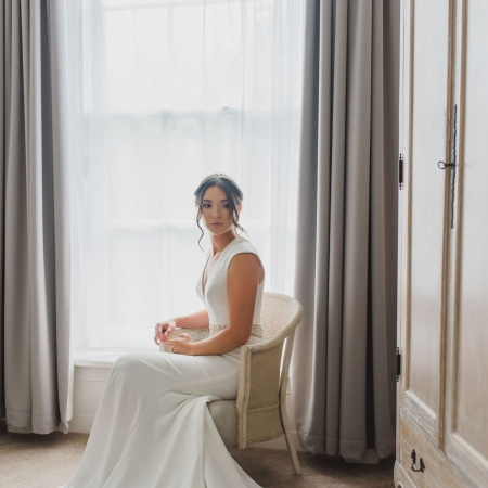 bride in bedroom at countryside wedding venue
